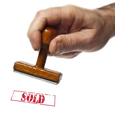 Sold stamp on white background photo