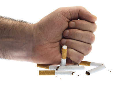 hand stop: Punch in cigarettes on white