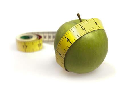 measurement tape: Measurement tape  and apple on white Stock Photo