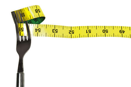 Fork and measurement tape on white photo