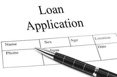 application form: Loan Application and an pen Stock Photo