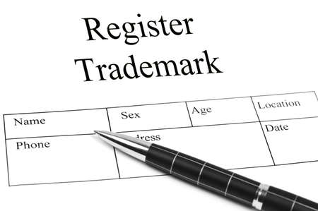 Register Trademrk Application and an pen photo