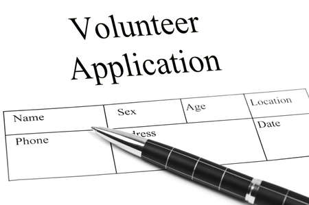 Volunteer Application and an pen Stock Photo - 10063227