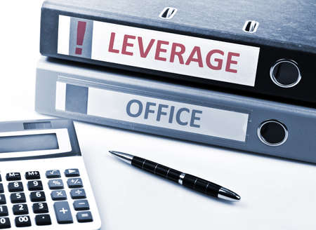 leverage: Leverage write on folder and office tools Stock Photo