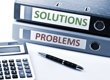 Solutions and Problems write on folder and office tools Stock Photo - 10063383