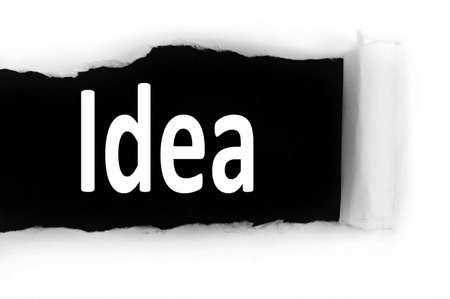 discovered: Idea word discovered under paper Stock Photo