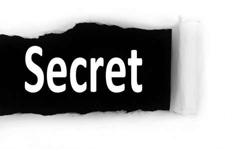 discovered: Secret word discovered under paper Stock Photo