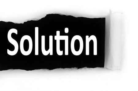 discovered: Solution word discovered under paper Stock Photo