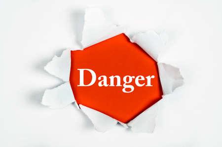 discovered: Danger word discovered under paper