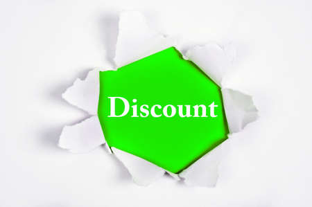 discovered: Discount word discovered under paper Stock Photo