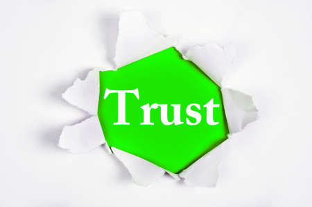 discovered: Trust word discovered under paper Stock Photo