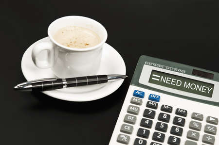 Need Money result on electronic calculator and coffee Stock Photo - 10063262