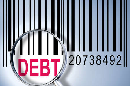 Debt under magnifyng glass on barcode photo