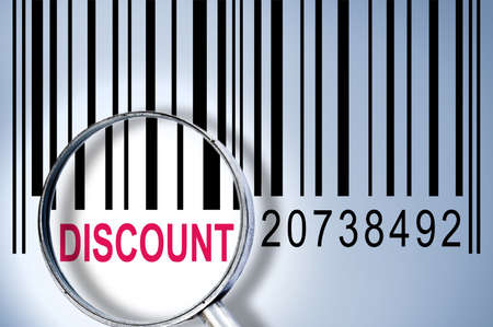 Discount under magnifyng glass on barcode photo
