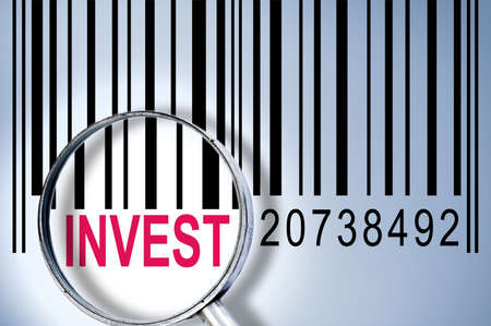 Invest under magnifyng glass on barcode photo