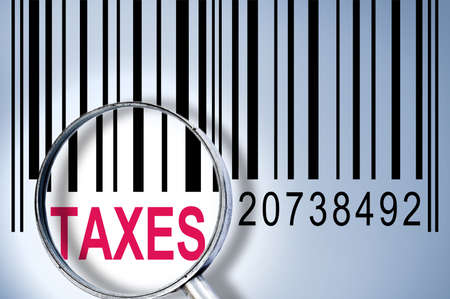 identifier: Taxes under magnifyng glass on barcode Stock Photo