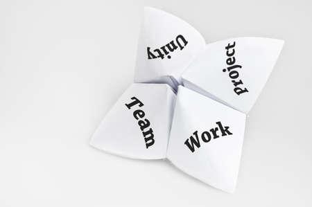 Teamwork on fortune teller paper photo