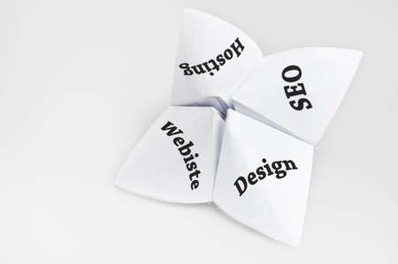 Online business needs on fortune teller paper photo
