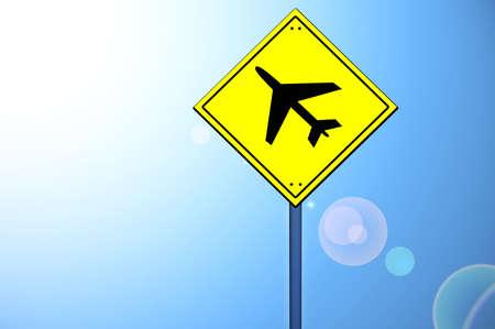 Plane shape on yellow road sign photo