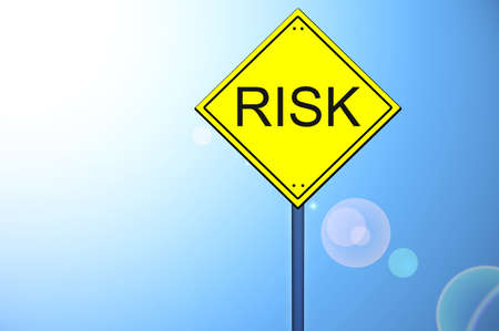 Risk on yellow road sign photo