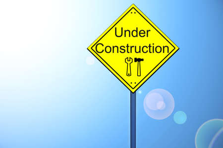 Under construction on yellow road sign photo