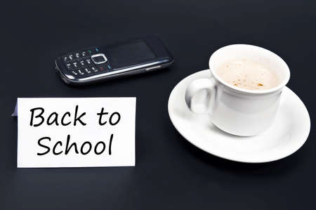 noted: Back to school noted on desk with coffee