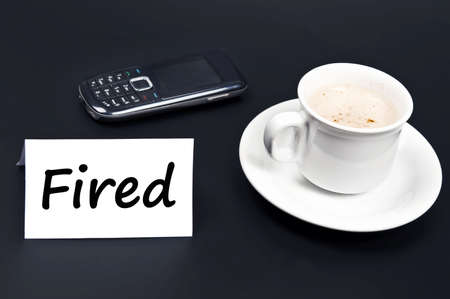 dismiss: Fired message on desk with coffee
