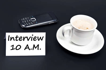 Interview message on desk with coffee Stock Photo - 10080030