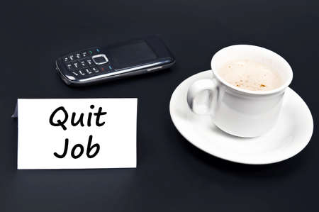 Quit job message on desk with coffee photo