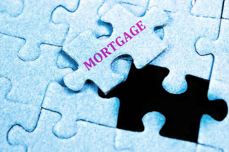 morgage: Morgage piece of puzzle on top Stock Photo
