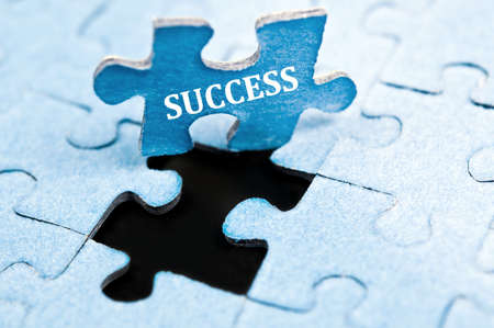 success concept: Success piece of puzzle stand up Stock Photo