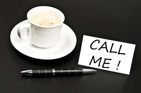 noted: Call me noted on desk with coffee Stock Photo
