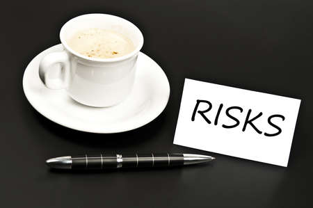 Risks message on desk with coffee photo