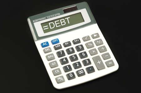 Debt word on electronic calculator photo