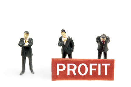 Profit note and business man toys photo