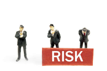 Risk note and business man toys photo