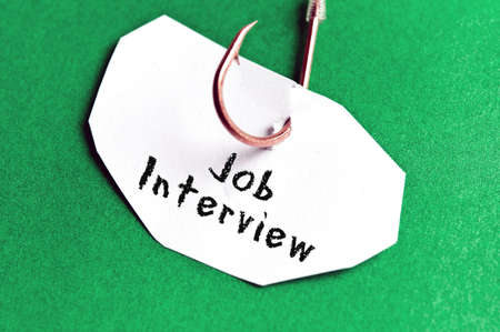 Job Interview message on paper on green background photo