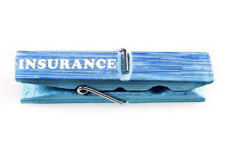 Insurance word on isolated laundry hook photo