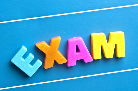 Exam word on blue board