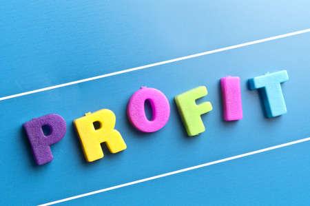 Profit word on blue board photo