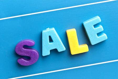 Sale word on blue board