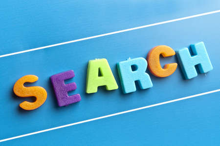 Search word on blue board Stock Photo