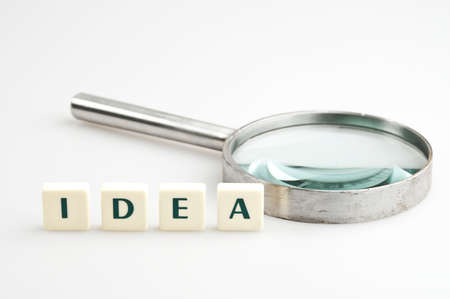 Idea word and magnifying glass photo