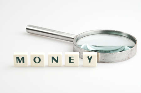 Money word and magnifying glass photo