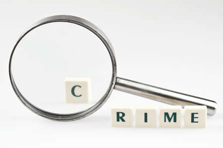 Crime word and magnifying glass Stock Photo - 11528855
