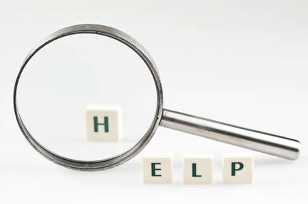 Help word and magnifying glass Stock Photo - 11528851