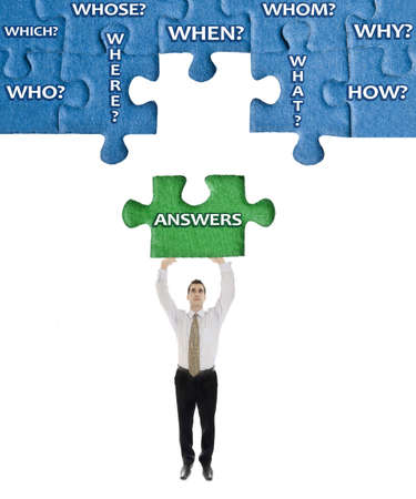 Answers word on puzzle in man hands photo