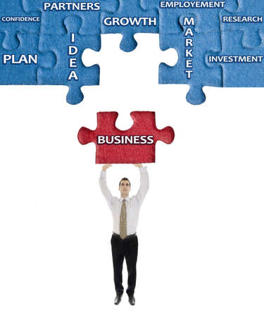 Business word on puzzle in man hands Stock Photo - 11529080