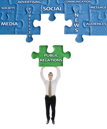 corporate social: Public Relations word on puzzle in man hands