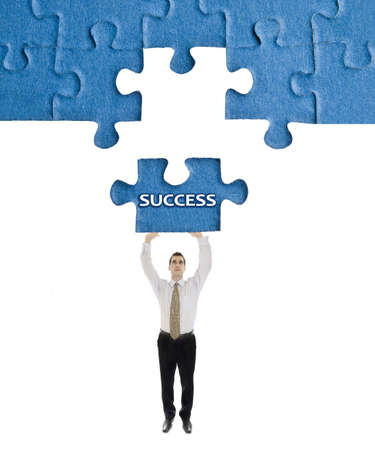 Success word on puzzle in man hands photo